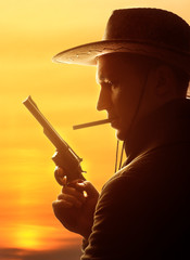 cowboy in hat with cigar and revolver