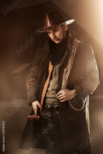 handsome man in cowboy clothes