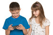 Two kids plaing with smartphone