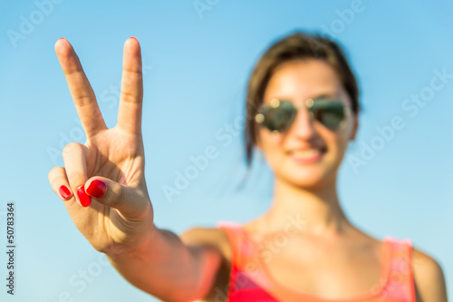 Girl Showing The Victory Sign