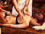 Woman having Ayurvedic spa treatment. - 50784972