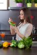 Beautiful woman eats salad