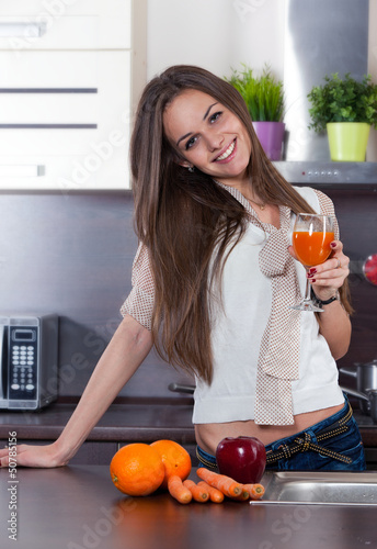 Young woman drinking fresh juice
