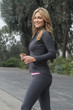 Physically fit woman walking