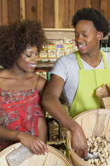 African American woman buying peanuts at the Supermarket