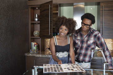 Young African American couple at new furnished kitchen