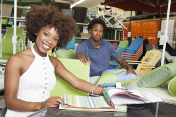 Young African American couple buying Outdoor furniture at Store