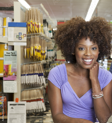 African American woman in hardware store