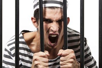 Convict yells through prison bars