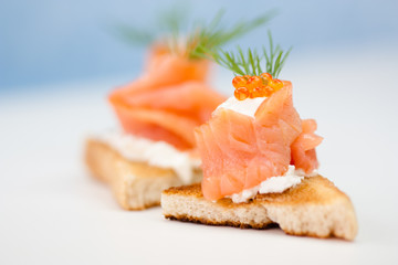 Smoked salmon finger food with caviar
