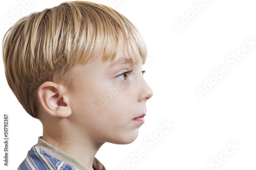 Close-up of young boy looking at copy space over white background