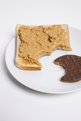 Slice of bread and chocolate biscuit on plate
