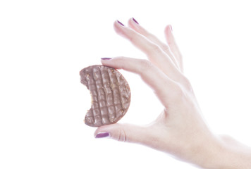 Detail shot of woman holding cookie over white background