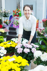 mature woman in flowers shop