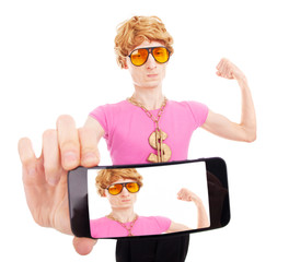Funny macho guy taking a self portrait with smart phone