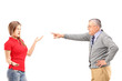 Angry father pointing at his daughter