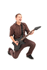 Full length portrait of a rock star playing a guitar