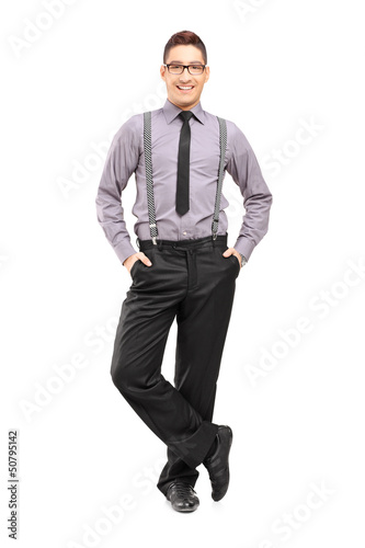 Full length portrait of a young stylish male posing