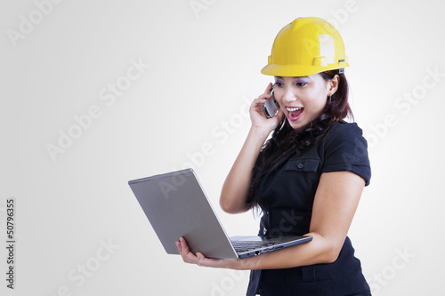 Architect laughing on the phone