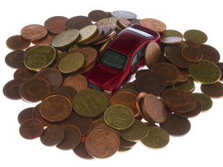 car under a pile of coins