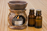 Aromatherapy lamp and oils on bamboo