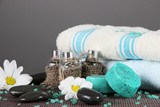 Oil spa towels on bamboo mat on gray background - 50799721
