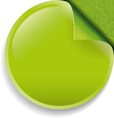 Round vector button with green leaf corner