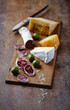 Spanish Salami, Brie and Hard Cheese on Wooden Board