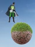 Eco superhero watering dried planet