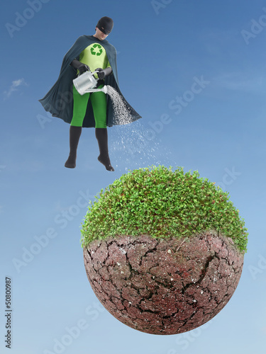 Eco superhero watering dried planet