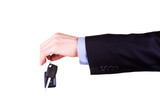 Male hand holding a car key . New car concept