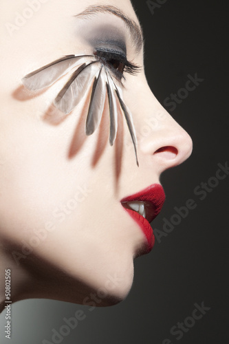 canvas print picture Beautiful woman profile with bird feathers