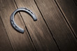 Iron horseshoe on a vintage background