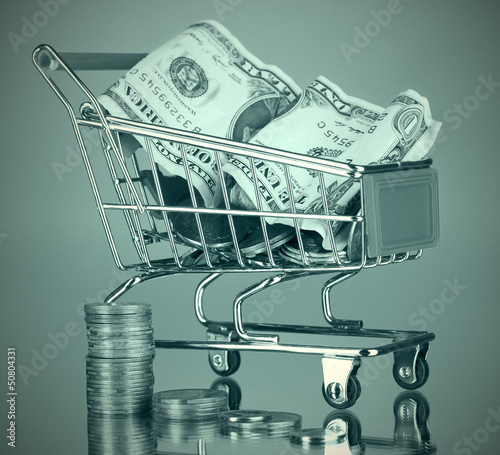 Money in cart in grey light