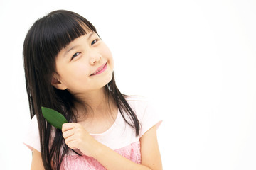 Beautiful asian girl with a leaf