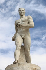 Statue of a runner in the Marble Stadium of Rome, Italy