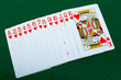 Playing cards red deck on the green background