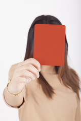 business woman showing red card
