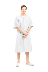 Full length portrait of a male patient in a hospital gown