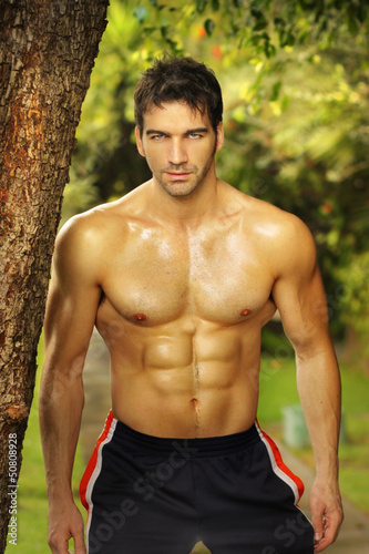 Natural portrait of a very fit male model outdoors