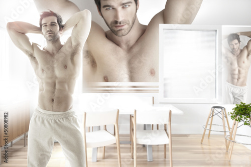 Sexy male model in modern interior