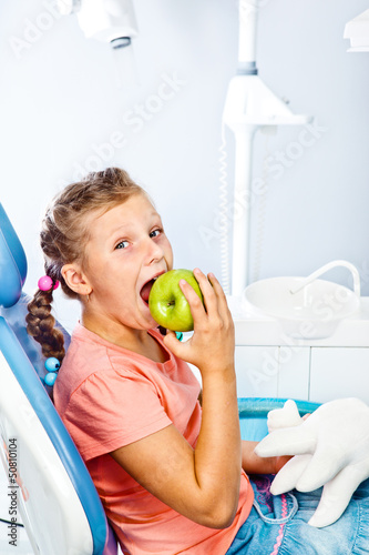 Healthy kid eating an apple