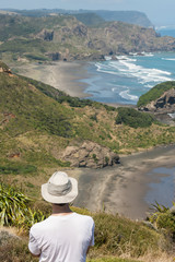 man admiring New Zealand coast