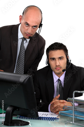 Executives with headphones and microphone