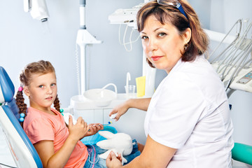Dentist giving oral hygiene instructions