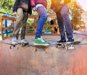 Skateboarders in skatepark