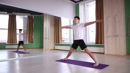 young and handsome male doing yoga 3
