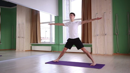 young and handsome male doing yoga 2