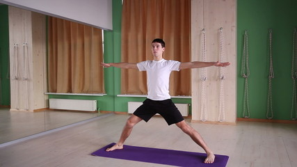 young and handsome male doing yoga 1