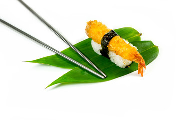 Sushi and stainless chop stick on bamboo leaf